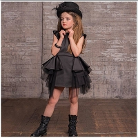 Black Peplum Dress from Little Wardrobe London